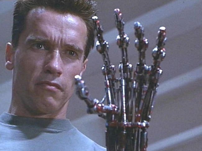 Picture of the Terminator from T2 staring at his bionic hand.